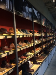 A wall of boots in the shop. It's been so long since I've worn clothes I actually covet, and seeing this many beautiful boots made me miss dressing well and not in spandex dearly.